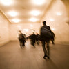 Motion blur images of people in the Grand Central Terminal galleries, NYC, USA