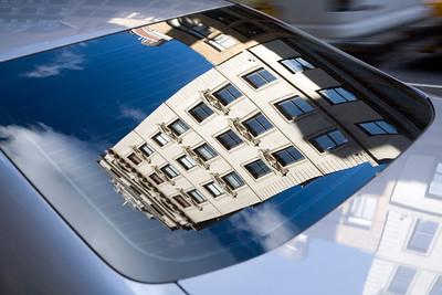 Building on 5th Av. reflected on a car rear window, NYC, USA