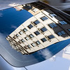 Building on 5th Av. reflected on a car rear window, NYC, USA