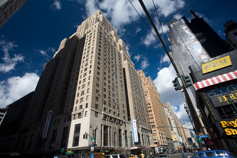 The New Yorker Hotel on 8th Avenue as seen from 34th street, NYC, USA