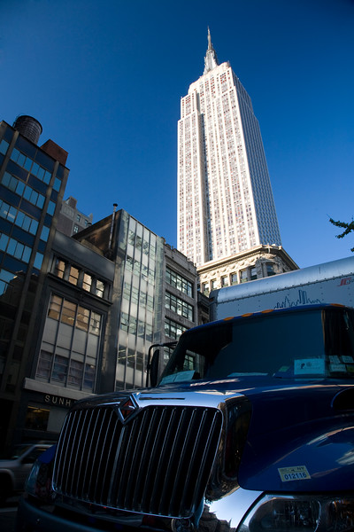 The Empire State Building and a truck on 5th Avenue, NYC, USA
