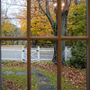 Fall scene seen from a wooden window, Connecticut, USA