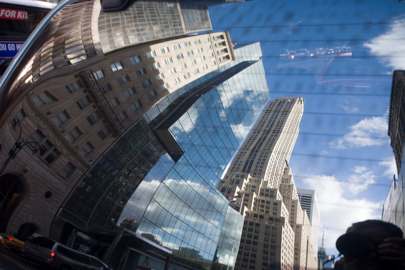 500 Fifth Avenue and other buildings reflected on the rear window of a car, NYC; USA