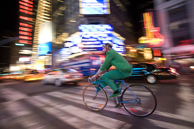 A man riding a bike at Times Square, NYC, USA