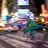 A man riding a bike at Times Square, NYC, USA