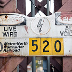 Warning sign of live wire in English and Spanish, CT, USA