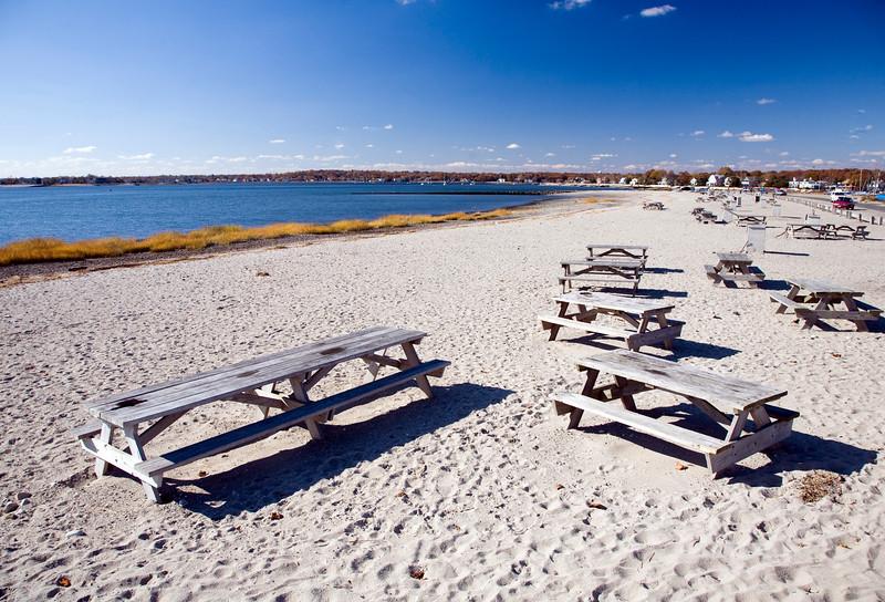 Empty picnic tables at Compo Beach, CT, USA