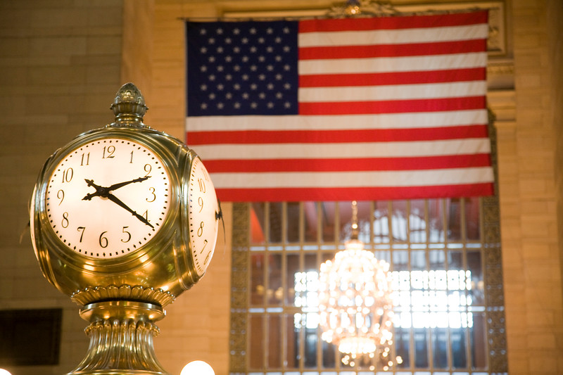 American Flag and Clock from the hall of Grand Central Terminal, NYC, USA