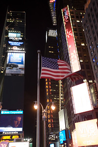 The American flag fluttering at Times Square, NYC, USA.