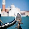 """Detail of a gondola """"ferro di prua"""" or prow iron, in front of San Giorgio Maggiore, Venice, Italy"""