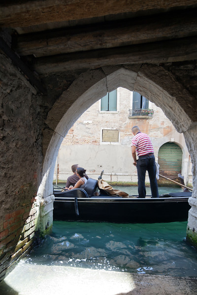 Gondolier at work, Venice, Italy