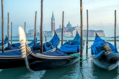 Moored gondolas with San Giorgio Maggiore on the background, Riva degli Schiavoni, Venice, Italy.