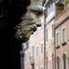 Ornament with the shape of a human head on a Venetian facade, Venice, Italy