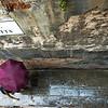 Lady with an umbrella walking on Crosetta street, Cannaregio quarter, Venice, Italy