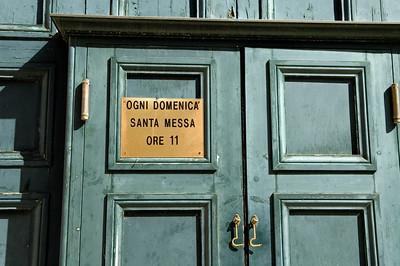 Sunday mass timetable on a church door, Venice, Italy
