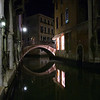 Nocturnal view of a bridge over a canal, Cannaregio quarter, Venice, Italy.