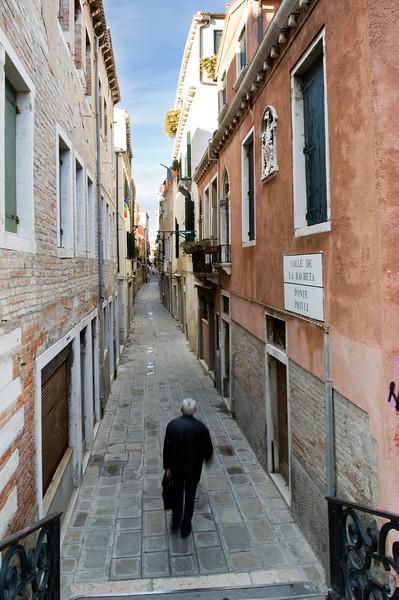 Lonesome walker, Rachetta street, Cannaregio quarter, Venice, Italy