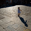 Little girl running on Santo Stefano square (Campo Santo Stefano), San Marco quarter, Venice, Italy. Model release available.