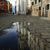 Gesuiti church reflected on a rain puddle, Cannaregio quarter, Venice, Italy
