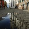 Gesuiti church reflected on a rain puddle, Cannaregio quarter, Venice, Italy