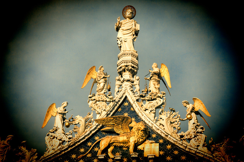 Saint Mark, the Venetian Lion and angels on the top of Saint Mark Basilica, Venice, Italy