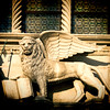 The Winged Lion and the Doge Francesco Foscari statues on the top of Porta della Carta Gate, Palazzo Ducale, Venice, Italy