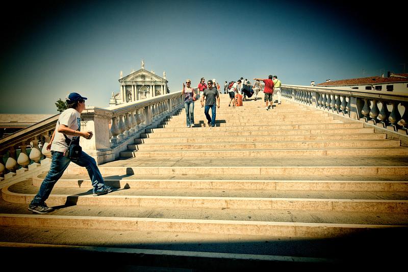 Pedestrians by Scalzi bridge, Venice, Italy