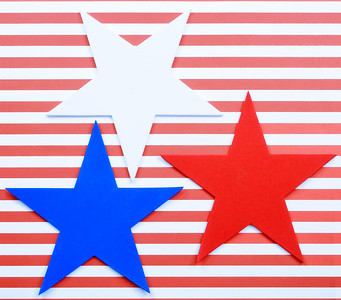 Cheerful red and white horizontal stripes form the background behind 3 foam cutout star shapes. Copy space. Good for USA patriotic holidays like July 4th, Memorial Day, Labor Day and Presidents Day.