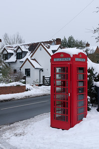 Red phone box in snow
