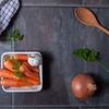 Carrots, garlic, onion and spoon.