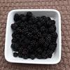 Blackberries on woven  background.