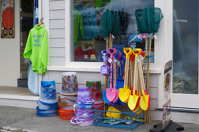 Colourful plastic buckets and spades outside a seasise shop.