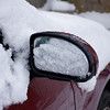 Snow melting from car mirror