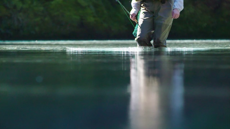 Wading in New Zealand fishing river