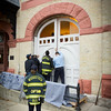 Woodstock FD installing replica doors at the Opera House Nov 1 2013