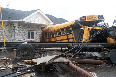 HENRYVILLE, IN - USA, MARCH 8, 2012- A school bus is pulled from a building in Henryville, IN, nearly a week after an EF-4 tornado struck the community on March 2, 2012.