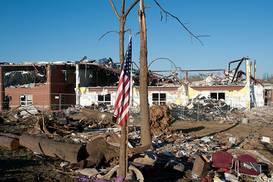 HENRYVILLE, IN - USA, MARCH 10, 2012- An American flag flies over the rubble in Henryville, IN, nearly a week after an EF-4 tornado struck the community on March 2, 2012.