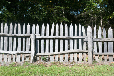 Old wooden fence on an old pasture