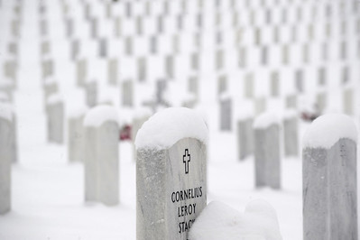 Snowfall blankets gravesites of United States military veterans in Jefferson Barracks National Cemetery