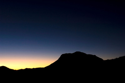 The sun is about to peek over the mountains in an early morning in Rocky Mountain National Park