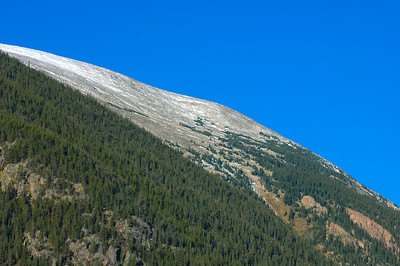 The side of a mountain in Rocky Mountain National Park and blue sky