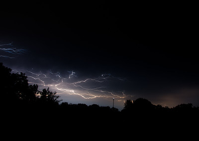 Bolts of lightning streak through the night sky before a thunderstorm in midwest United States