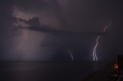 Lightning bolts strike the ocean near gul shores