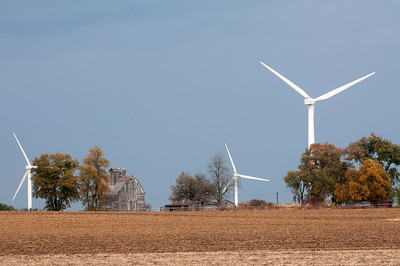 Wind turbines at windfarm and an old barn in rural midwestern US