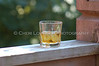 Whiskey, Bourbon or Scotch on the rock with outdoor deck setting.