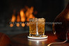Whiskey, Bourbon or Scotch on the rocks with fireplace setting as backdrop.