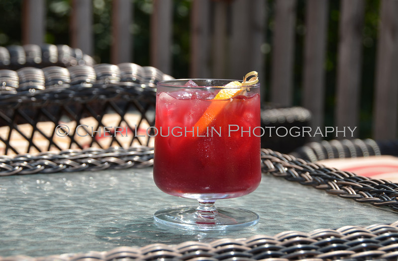 Red Cocktail with Orange & Lime Garnish 144-2011-07-20