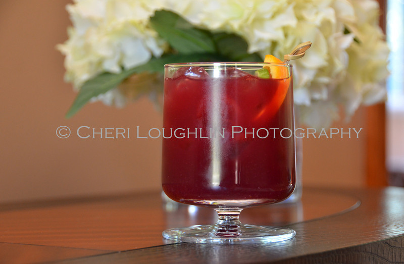 Red Cocktail with Orange & Lime Garnish 137-2011-07-20