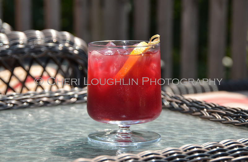 Red Cocktail with Orange & Lime Garnish 145-2011-07-20