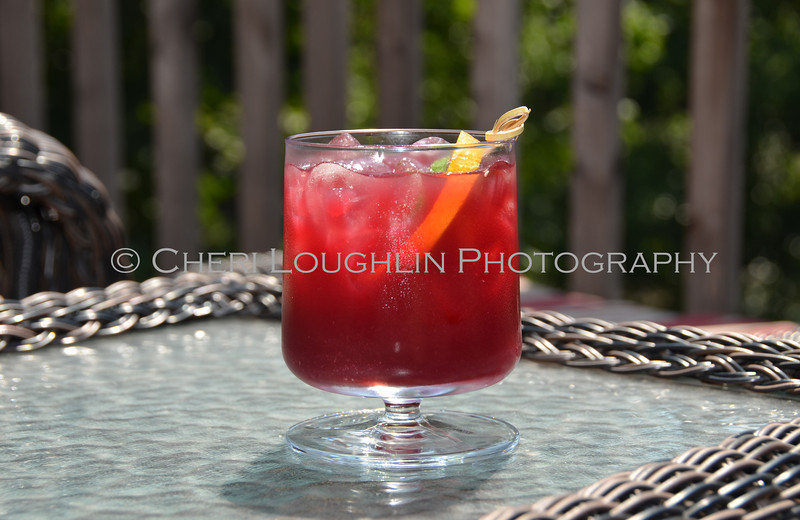 Red Cocktail with Orange & Lime Garnish 141-2011-07-20